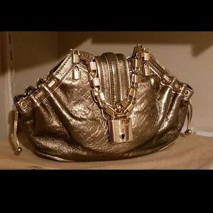 Authentic louis Vuitton mini Gold locks Theda